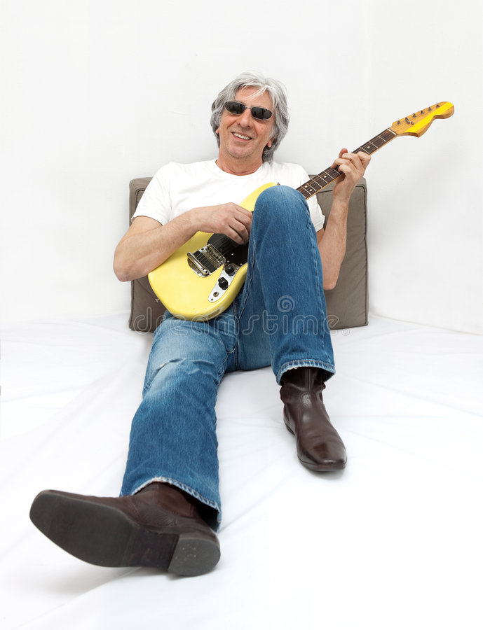 冷静吉他弹奏者 免版税库存照片