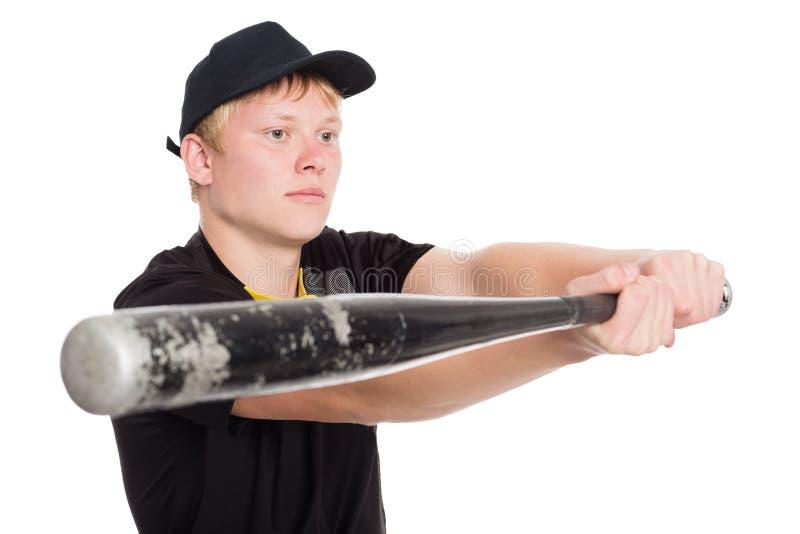 准备严肃的棒球运动员的棒触击 免版税库存照片