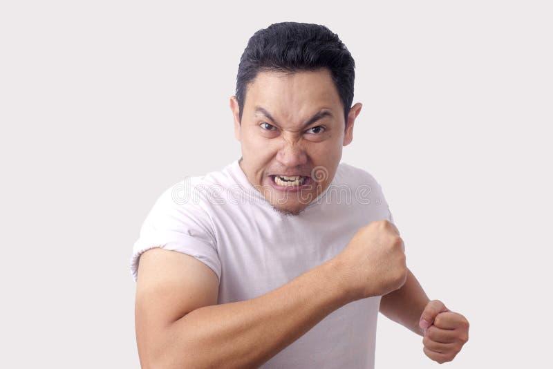 准备好恼怒的亚洲人的表示战斗 图库摄影