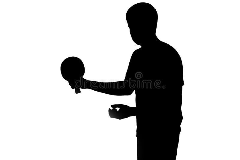 准备好的运动员的剪影击中乒乓球 免版税库存图片