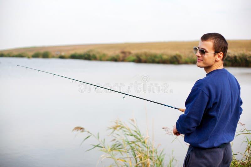 凉快的人渔 免版税库存照片