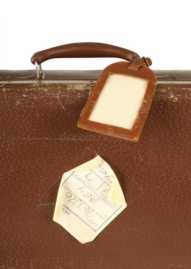 减速火箭的手提箱标签旅行 免版税库存照片