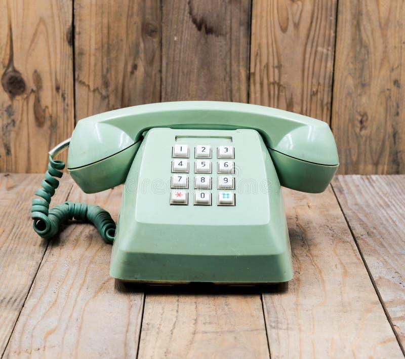 减速火箭的绿色电话 库存图片