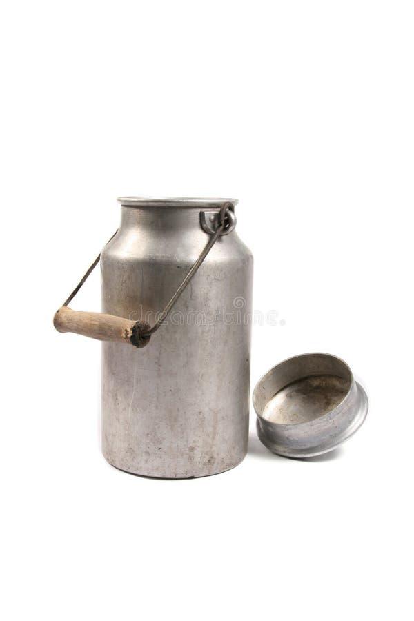 减速火箭的罐装牛奶 免版税库存图片