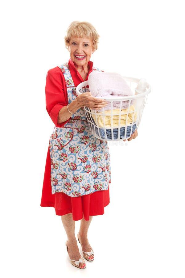 减速火箭的资深夫人-洗衣店 免版税库存图片