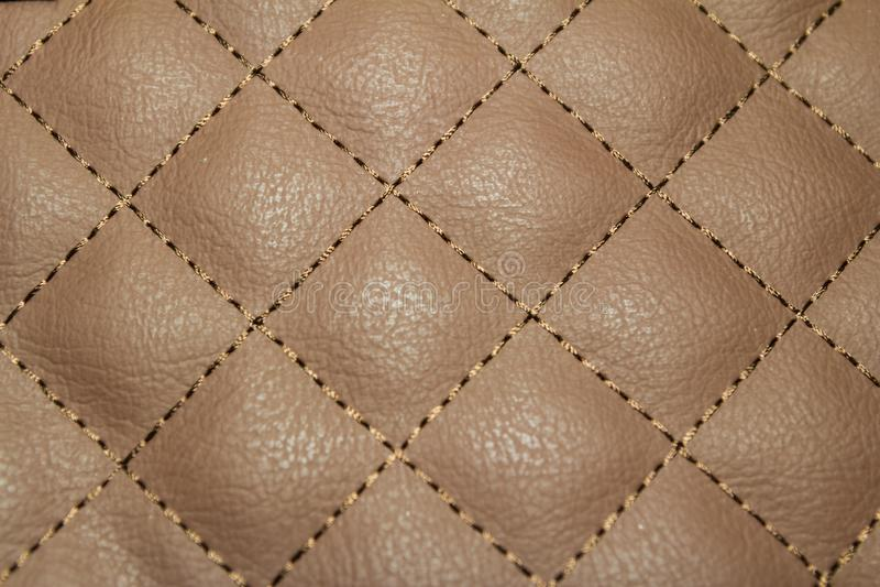 几何金刚石样式缝制了PU皮革 免版税库存图片
