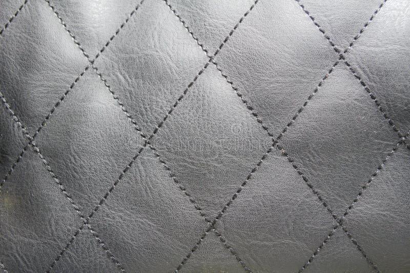 几何金刚石样式缝制了PU皮革 免版税库存照片
