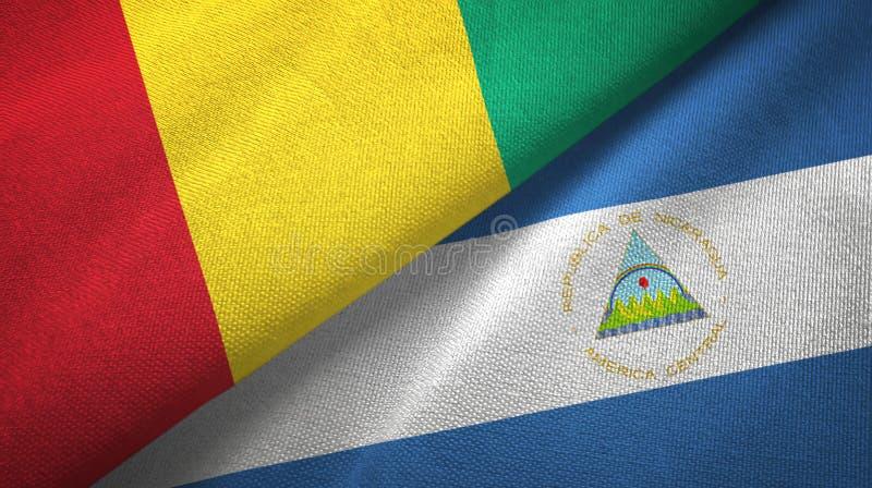 几内亚和尼加拉瓜两旗子纺织品布料,织品纹理 皇族释放例证