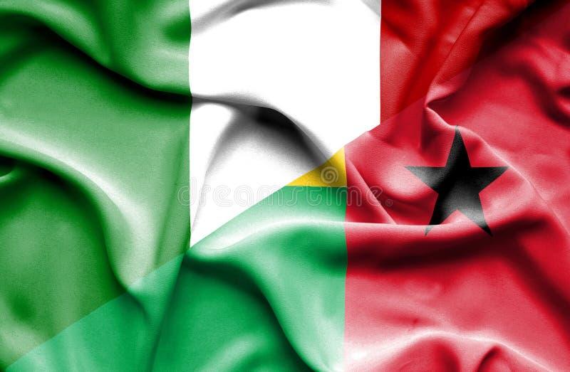 几内亚比绍和意大利的挥动的旗子 皇族释放例证