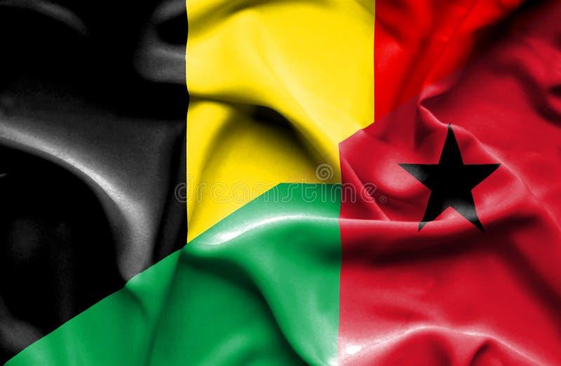 几内亚比绍和比利时的挥动的旗子 库存例证