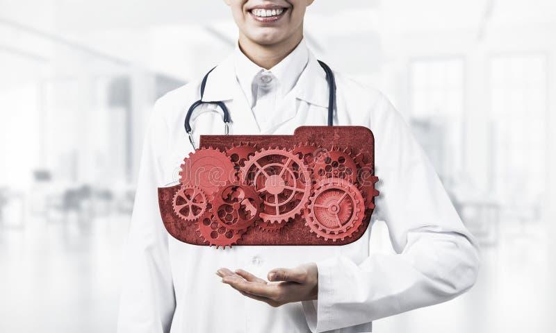 出席在她的棕榈的医学工作者覆盖计算的概念 库存图片