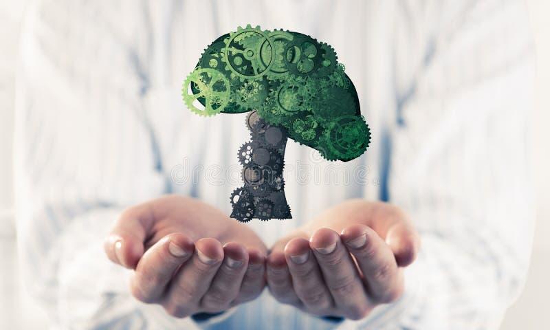 出席在棕榈eco绿色概念的商人象征了机智 免版税库存图片
