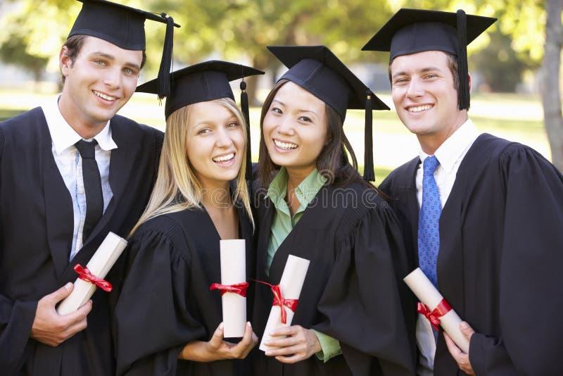出席毕业典礼的小组学生 库存图片