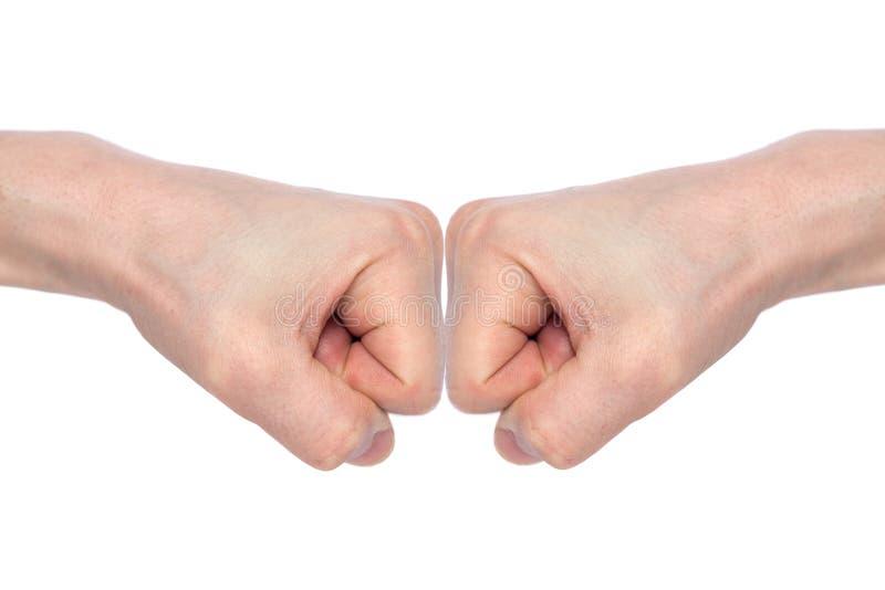 击中的两个男性拳头,隔绝在白色背景 企业成功和配合的概念 r 库存图片