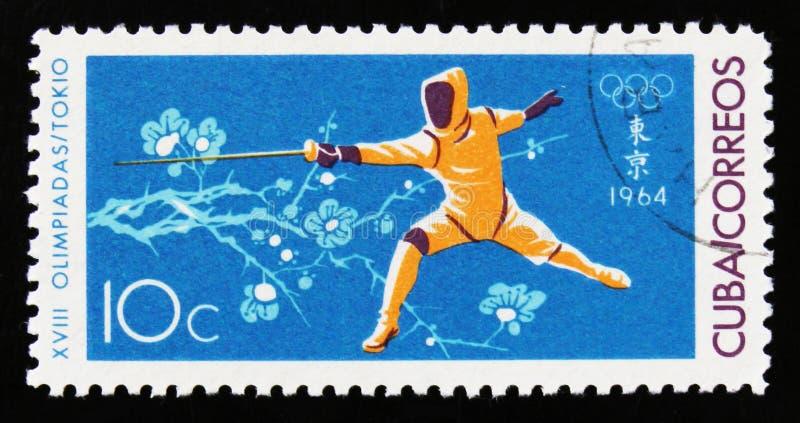 击剑者,第18次奥运会在东京,大约1964年 库存图片