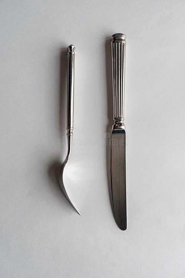 刀子和叉子在白色背景 免版税库存照片