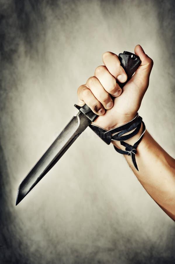 刀子在手中 免版税库存图片