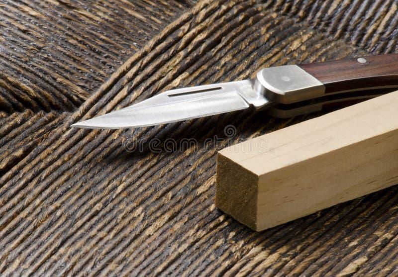刀子钉正方形 库存图片