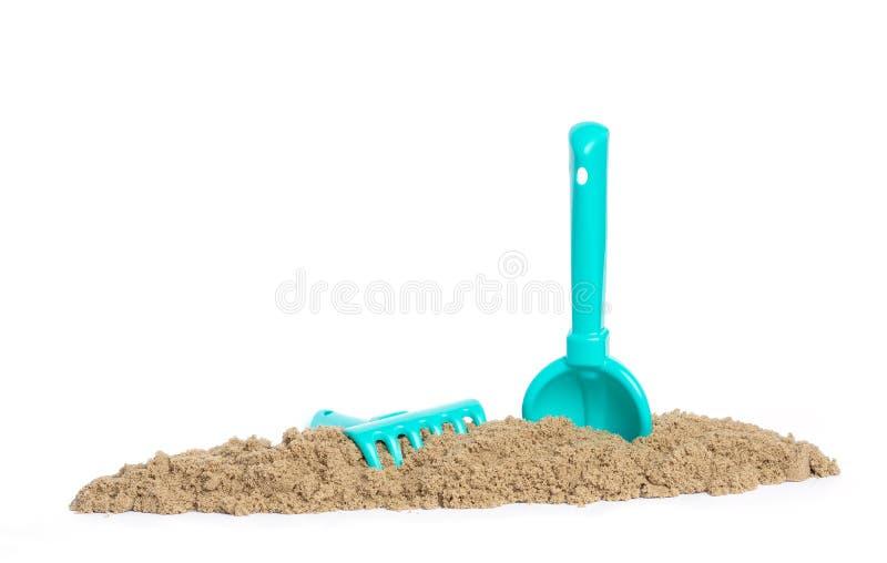 刀片和犁耙在运动沙子在 子项的比赛 免版税库存照片