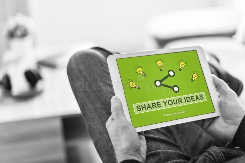 分享在片剂的想法概念 免版税库存照片