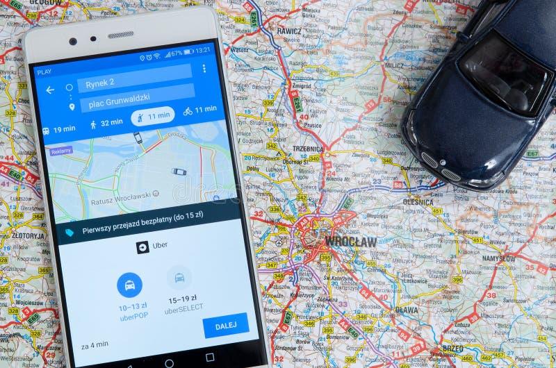 分享经济服务的Uber在弗罗茨瓦夫 库存照片