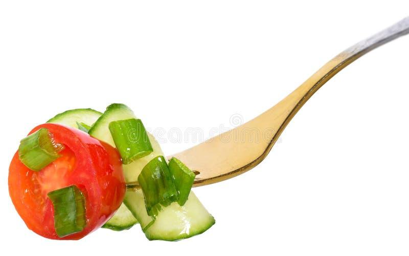 分叉与从被隔绝的蕃茄和黄瓜的沙拉菜 库存照片