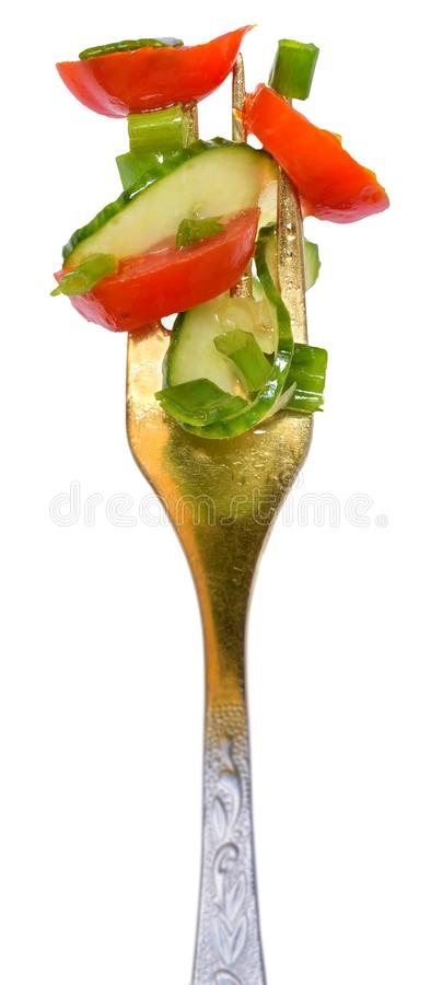 分叉与从被隔绝的蕃茄和黄瓜的沙拉菜 图库摄影