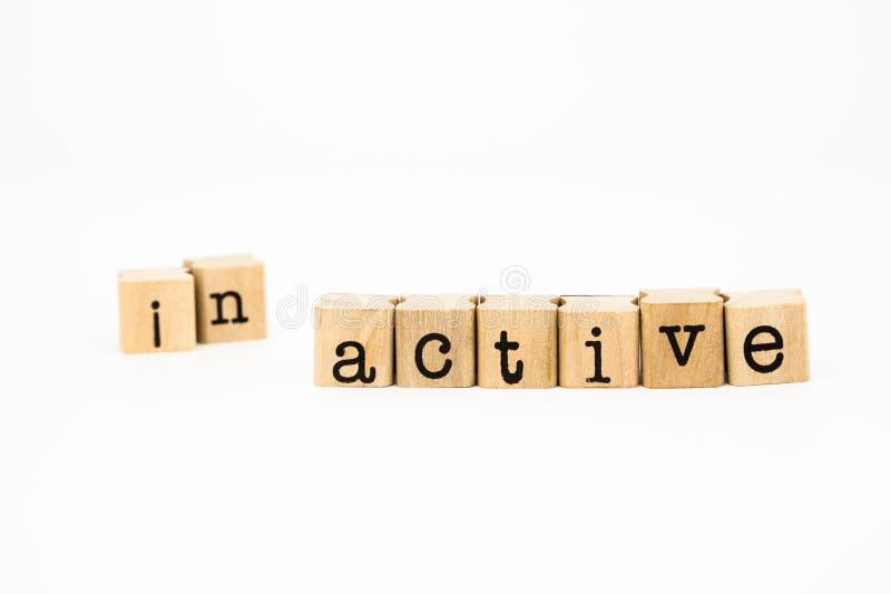 分裂不活泼的字词,刺激概念的活跃字词 库存照片
