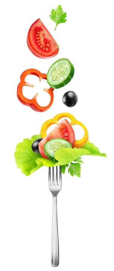 切开在叉子的新鲜蔬菜 免版税库存照片
