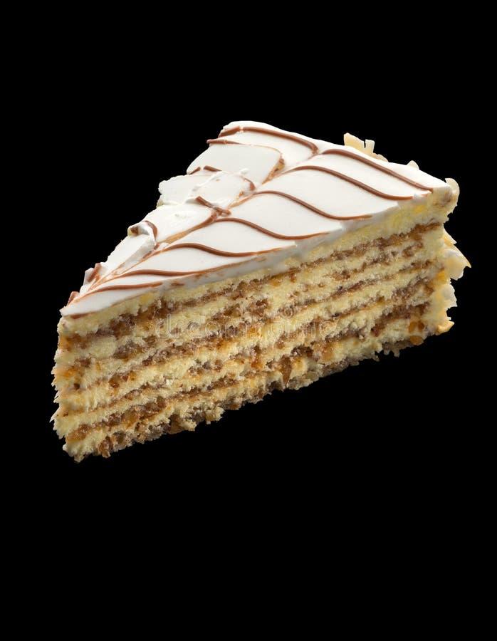 切片蛋糕用用almo装饰的白色巧克力 库存照片