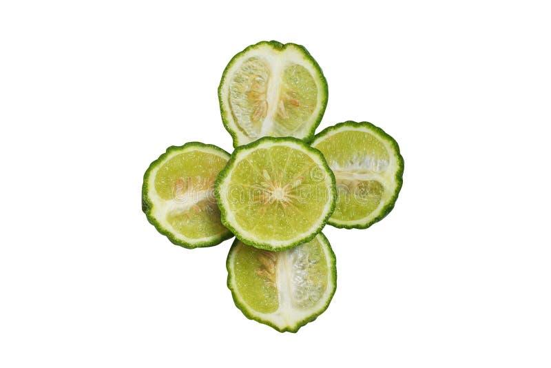 切片香柠檬在白色背景在花形状的非洲黑人石灰隔绝的 免版税库存照片