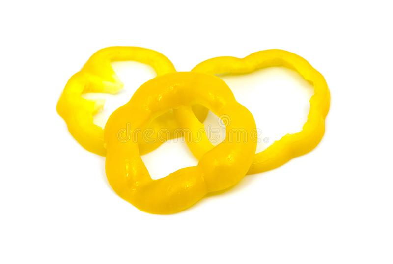 切片黄色喇叭花胡椒被隔绝在白色背景 免版税库存照片