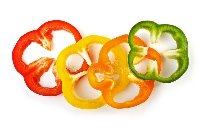 切的甜五颜六色的胡椒查出在白色 库存图片