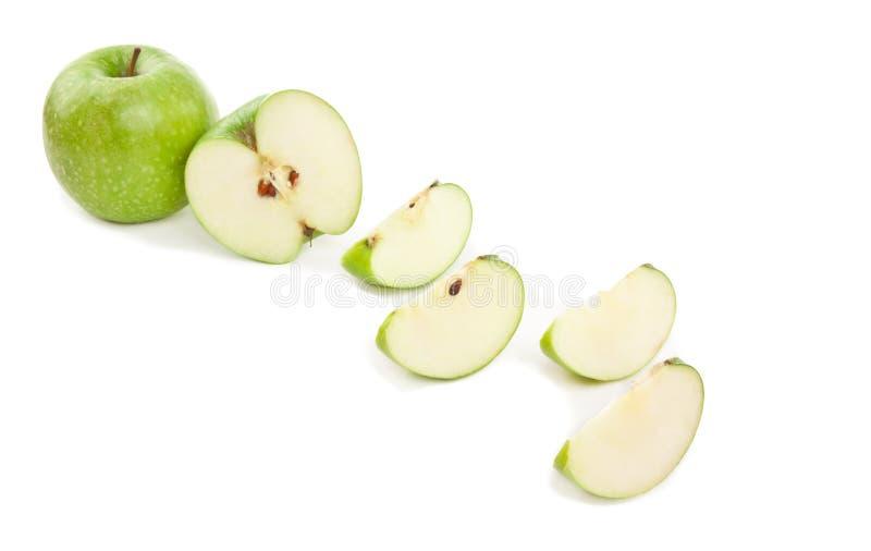 切的绿色苹果的图片在白色的 库存照片