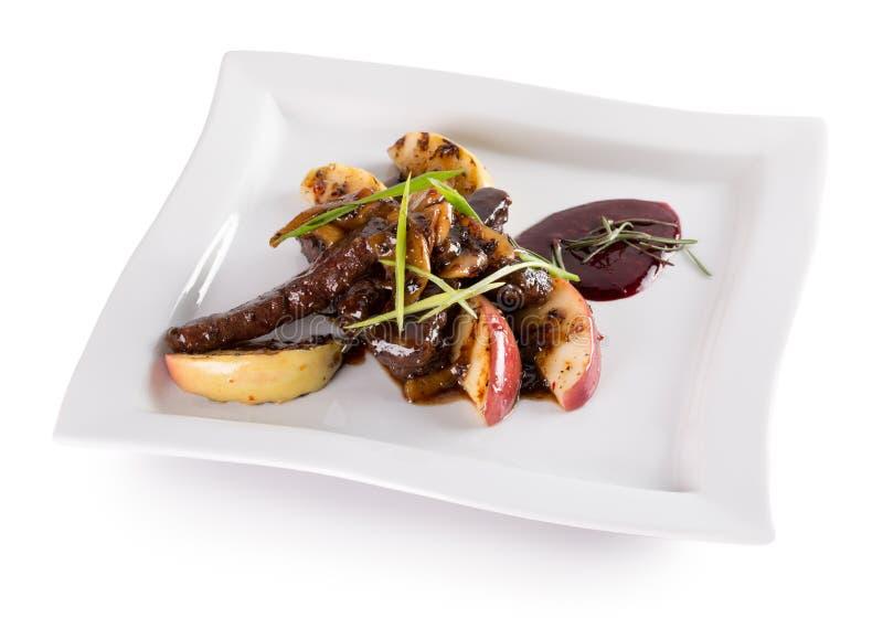切的肉用烤土豆用焦糖的调味汁 图库摄影