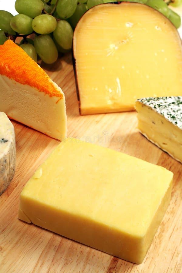 切达乳酪cheeseboard 库存照片