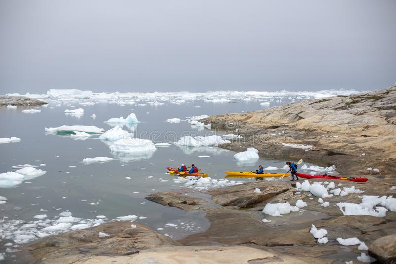 划皮船在伊卢利萨特Icefjord,格陵兰 库存图片