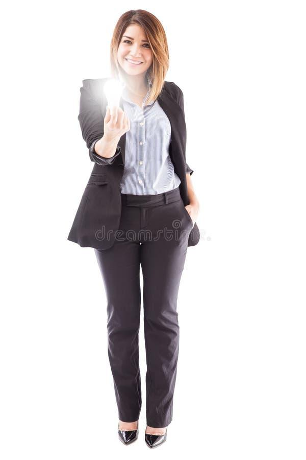 创造性的女实业家有一个新的想法 库存图片