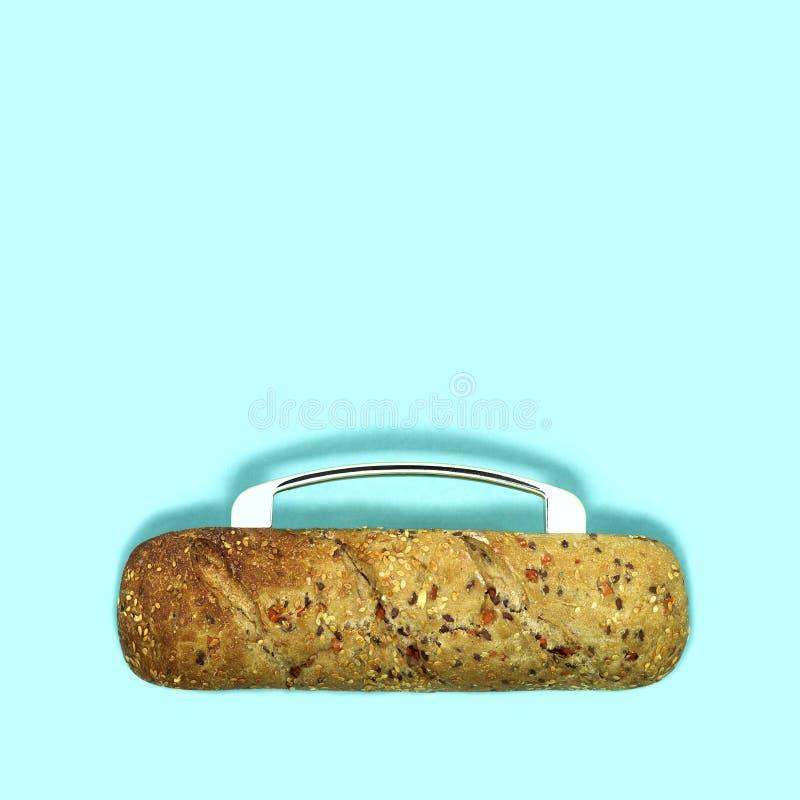 创造性的想法:与种子的全麦面包作为袋子 库存照片