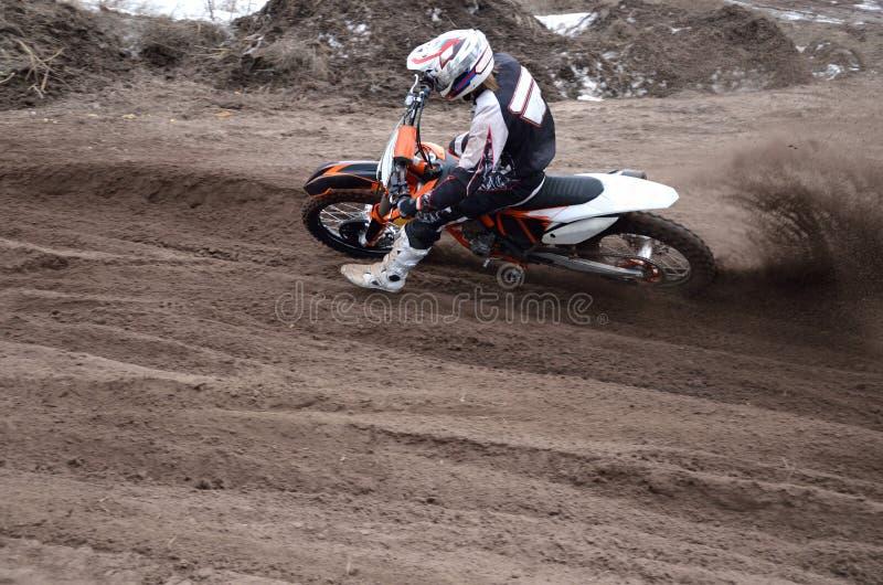 删去摩托车越野赛点车手沙子改变方向 库存照片