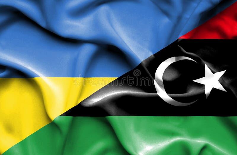 利比亚和乌克兰的挥动的旗子 向量例证