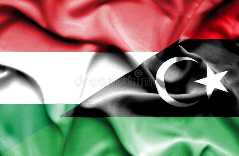 利比亚和匈牙利的挥动的旗子 向量例证