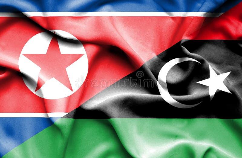 利比亚和北朝鲜的挥动的旗子 库存例证