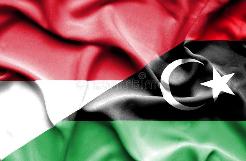 利比亚和印度尼西亚的挥动的旗子 库存例证