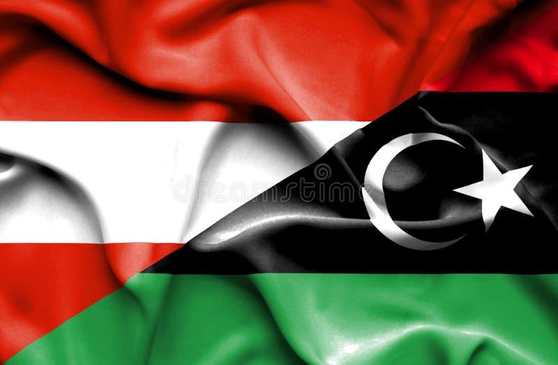 利比亚和奥地利的挥动的旗子 皇族释放例证