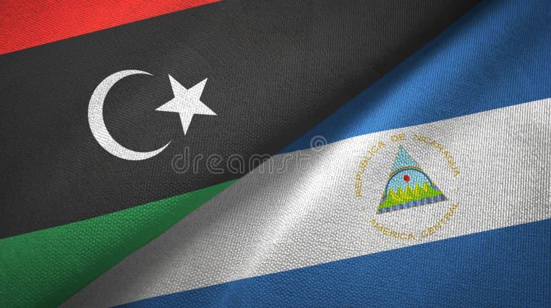 利比亚和尼加拉瓜两旗子纺织品布料,织品纹理 向量例证