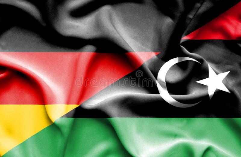 利比亚和德国的挥动的旗子 库存例证