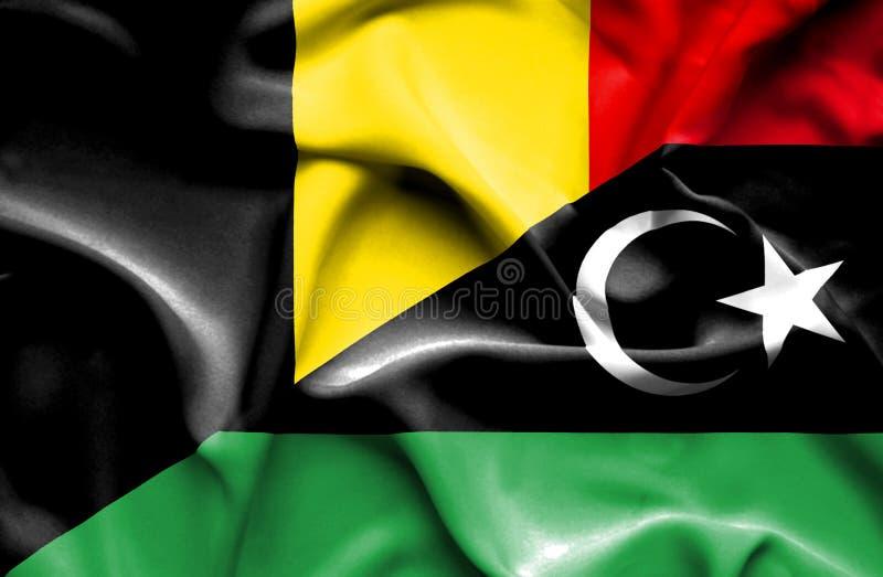 利比亚和比利时的挥动的旗子 向量例证