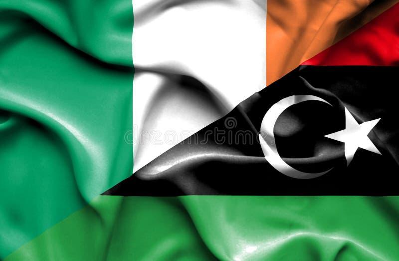 利比亚和爱尔兰的挥动的旗子 皇族释放例证