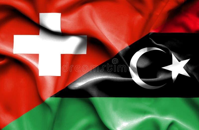 利比亚和瑞士的挥动的旗子 库存例证